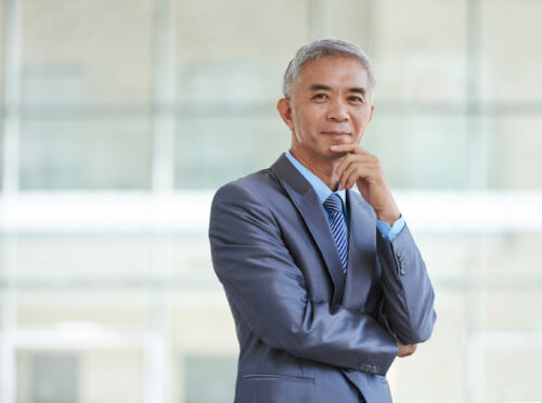 Portrait of happy Taiwan businessman looking at camera